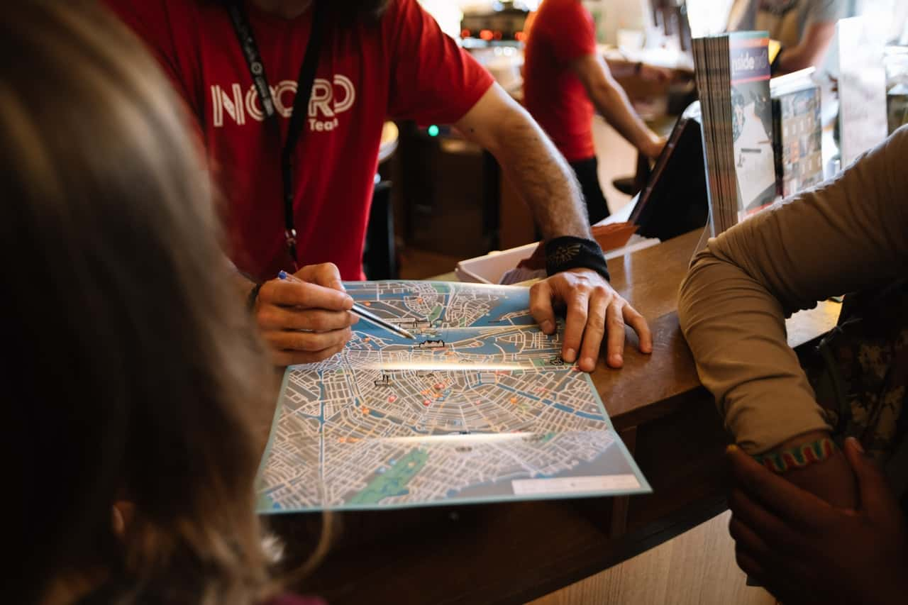 Man using pen to point on a map